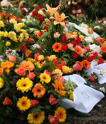 Trauerfloristik Blumengesteck Sargschmuck
